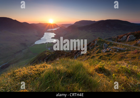 A view of Buttermere at sunset, from the summit of Fleetwith Pike in the Lake District. - Stock Image