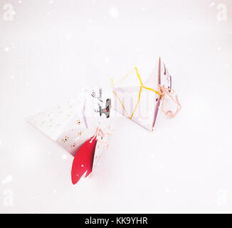 Christmas Decoration with cake slice gift boxes and Lights with snow falling for best background image for Holiday - Stock Image