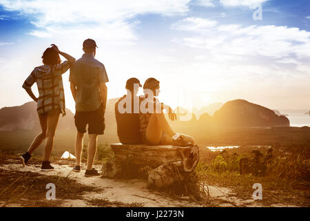 Friendship and travel concept at sunset or sunrise - Stock Image