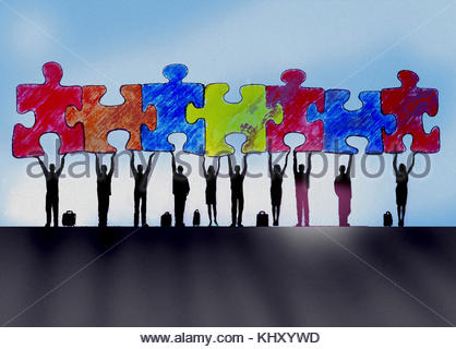 Business people in a row holding up connected jigsaw puzzle pieces - Stock Image