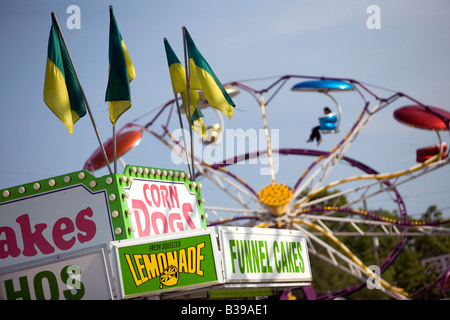 A carnival food stand and Paratrooper ride at Frisco Fest in Rogers, Arkansas, U.S.A. - Stock Image