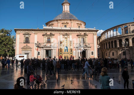 People watch a theatrical performance outside Basílica de la Virgen de los Desamparados, a shrine to the patron saint of Valencia, Spain. - Stock Image