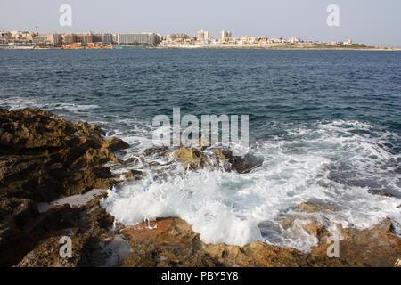 At Ghallis Point looking across Salina Bay towards Qawra in Malta - Stock Image