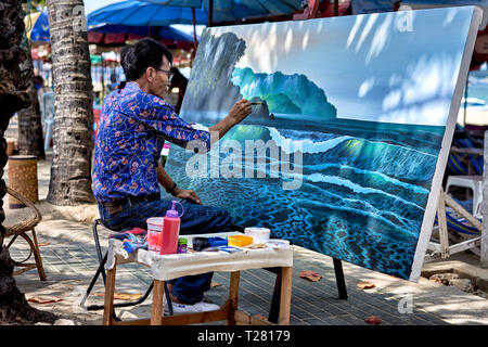 Artist painting a  landscape canvas outdoors. Thailand Southeast Asia - Stock Image