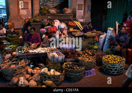 Balinese woman working at Ubud Markets Bali Indonesia - Stock Image