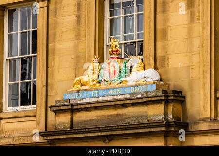 The Royal Coat of Arms on a building at the quayside, Newcastle, UK. - Stock Image