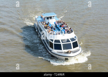 The upper deck of a tourist cruise boat on the River Thames in London, UK - Stock Image