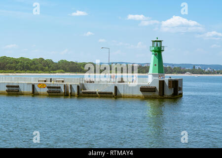 Nowy Port tourists admiring the views from the Western Breakwater and lighthouse, Gdansk, Poland, Europe - Stock Image