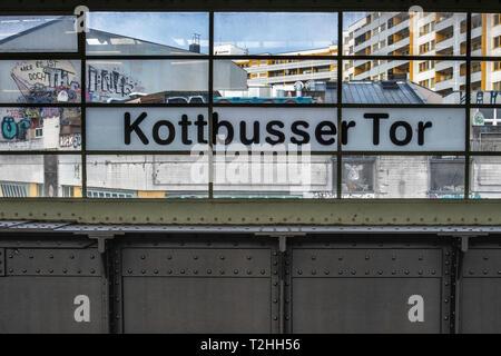 Berlin, Kreuzberg.Kottbusser Tor U-Bahn underground railway station name on window  Elevated station on raised viaduct. - Stock Image