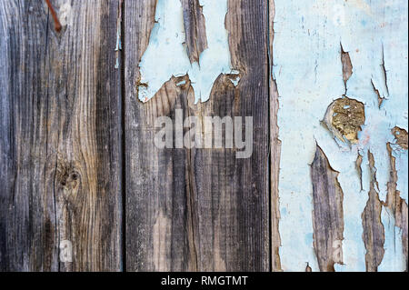 An old wooden door with the paint flaking off - Stock Image