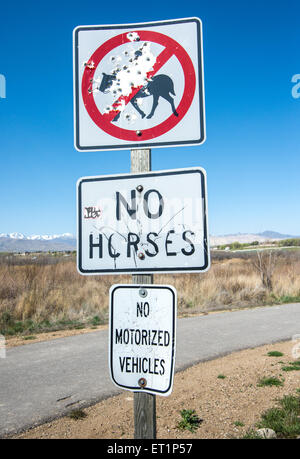 Sign vandalism along the Jordan River Parkway, a green space in Salt Lake County, Utah - Stock Image