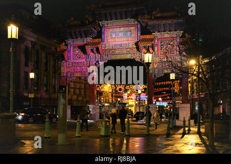 Liverpool, UK. 5th February, 2019. Chinese lanterns and colourful lights light up Nelson Street on Tuesday evening, February 5, in Liverpool's Chinatown for the start of Chinese New Year. The Chinese Arch at the entrance of Nelson Street is also lit up. Credit: Pak Hung Chan/Alamy Live News - Stock Image