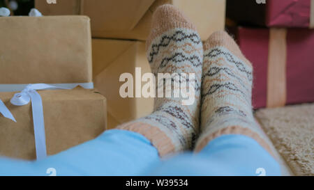 Woman feet in warm socks - Stock Image