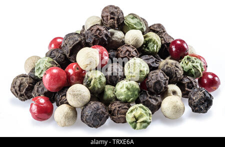 Black, white, green and red peppercorns isolated on white background. - Stock Image