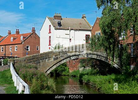 The old packhorse bridge over the River Leven, Stokesley, Hambleton, North Yorkshire, England UK - Stock Image