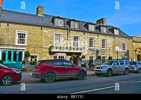A general street view of the High Street in Cowbridge with the historic Bear Hotel in the Winter sunshine.High Street. Vale of Glamorgan,South Wales - Stock Image
