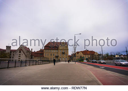 Poznan, Poland - November 21, 2018: Walkway with bicycle route leading to the Adam Mickiewicz University of economics building on the Swiety Marcin st - Stock Image