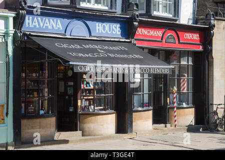 Cigar Merchants and Barber shops in High Street, Oxford with bow-fronted windows - Stock Image