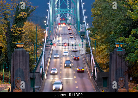 Lion's Gate Bridge in Vancouver BC Canada in the Autumn at dusk. Traffic coming over and leaving Stanley Park via the bridge. - Stock Image