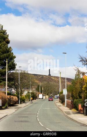 The B6215 Holcombe Road, Greenmount, Bury, Lancashire, looking towards the Peel Monument tower on Holcombe Moor. - Stock Image