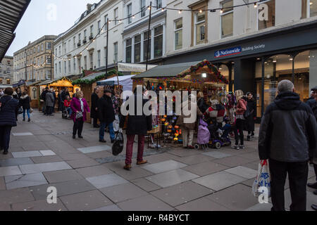 Shoppers browsing the wooden hut stalls in Union Street on the opening weekend of the 2018 Bath Christmas Market - Stock Image