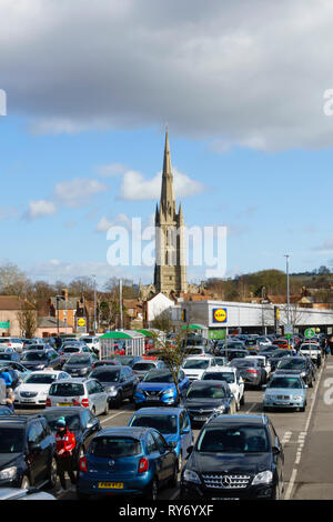 ASDA supermarket car park, with St Wulfrums church and Lidl store. Grantham, Lincolnshire, England - Stock Image