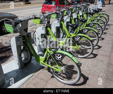 Green bikes.  A non-profit bike sharing program in Salt Lake City Utah, designed to improve air quality, and human - Stock Image