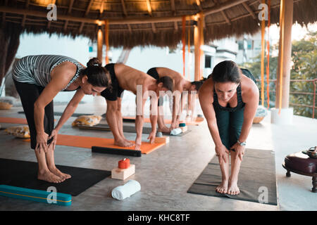 Group of motivated people exercising yoga at a retreat in Mexico - Stock Image