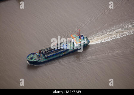An aerial view of a small cargo ship - Stock Image