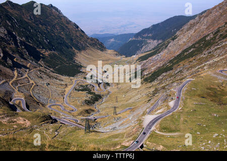 High angle view of winding roads against mountains - Stock Image