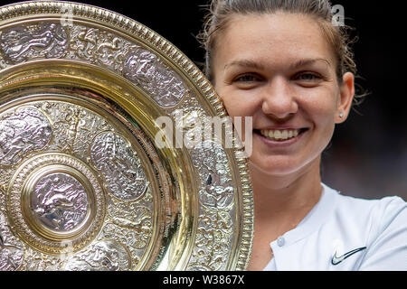 London, UK. 13th July, 2019. The All England Lawn Tennis and Croquet Club, Wimbledon, England, Wimbledon Tennis Tournament, Day 12; Simona Halep (ROM) holds the Venus Rosewater Dish after winning the womens singles final Credit: Action Plus Sports Images/Alamy Live News - Stock Image