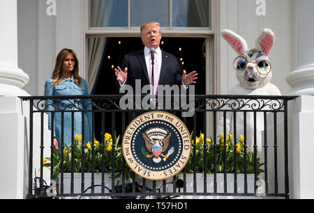 Washington, United States Of America. 22nd Apr, 2019. United States President Donald J. Trump, accompanied by First Lady Melania Trump and the Easter Bunny, delivers remarks at the White House Easter Egg Roll at the White House in Washington, DC on April 22, 2019. Credit: Kevin Dietsch/Pool via CNP | usage worldwide Credit: dpa/Alamy Live News - Stock Image