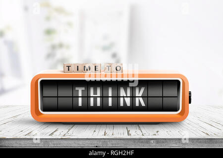 Time to think text on an old alarm clock in a bright room on a table - Stock Image