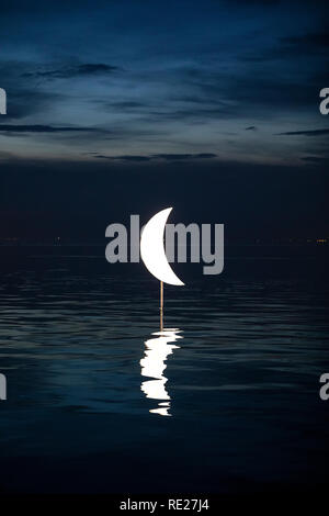 Lighting of the sculpture 'Moon in the Coast' at the seafront of Thessaloniki, January 18, 2019. - Stock Image
