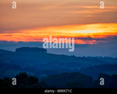 Hazleton Clump Cairn, Ashbourne. 2nd Jun, 2018. UK Weather: spectacular sunset over the ancient woods Hazleton Clump Cairn near Thorpe taken from Ashbourne Derbyshire, Peak District National Park Credit: Doug Blane/Alamy Live News - Stock Image
