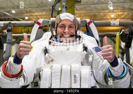 Boeing Commercial Crew Program astronaut Josh Cassada gives a thumbs up in his spacesuit before entering the pool at the Neutral Buoyancy Laboratory for ISS EVA training in preparation for future spacewalks while onboard the International Space Station at the Johnson Space Center April 12, 2019 in Houston, Texas. - Stock Image