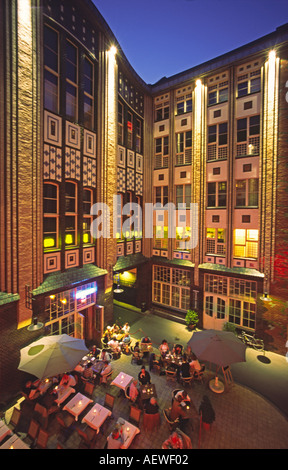Berlin Hackescher Markt modernised courtyard at night restaurants outdoor in summer - Stock Image
