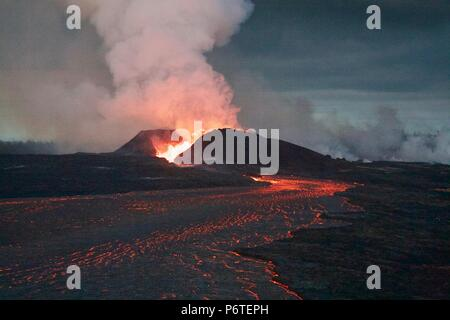 A massive lava fountain spewing magma 180 feet into the air from fissure 8 caused by the eruption of the Kilauea volcano June 30, 2018 in Hawaii. The recent eruption continues destroying homes, forcing evacuations and spewing lava and poison gas on the Big Island of Hawaii. - Stock Image