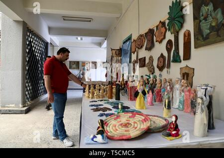 Baghdad, Iraq. 23rd Apr, 2019. A man views crafts displayed at the Festival of the Institute of Crafts and Folk Arts in Baghdad, Iraq, April 23, 2019. Credit: Khalil Dawood/Xinhua/Alamy Live News - Stock Image
