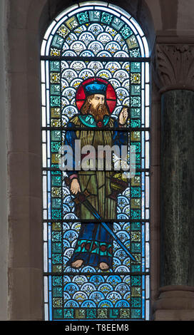 Pre-Raphaelite stained glass depicting Levi son of Jacob and Leah, St Catherine church Hoarwithy Herefordshire England UK. February 2019. - Stock Image
