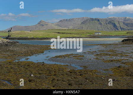 View across Canna harbour to isle of Sanday and Rum. Small Isles, Scotland. June. - Stock Image