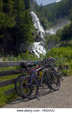 Mountain bikes parked at trekking and biking path, Stuiben waterfalls, Umhausen, Ötztal Valley, Austria. Tallest - Stock Image
