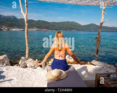 Woman enjoying a day at the beach in Thasos (Thassos), Greece - Stock Image