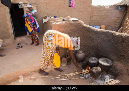 Kourono village, Yako province, Burkina Faso; Elizabeth Toro, 36 cooking. Her husband Moussa Mande, 54,  is a  goat project beneficiary. - Stock Image