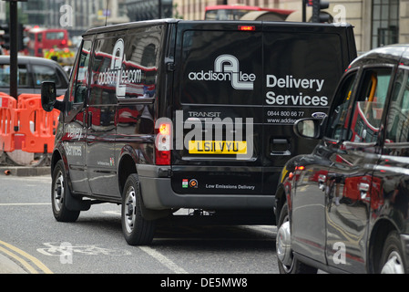 Delivery van at the traffic lights - Stock Image