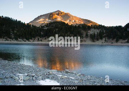Lassen Peak reflects the Suns color at sunrise - Stock Image