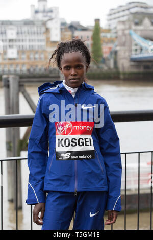 London,UK,25th April 2019,Brigid Kosgei(Ken) attends The London Marathon Elite Women's Photocall which took place outside the Tower Hotel with Tower Bridge in the background ahead of the Marathon on Sunday. Credit: Keith Larby/Alamy Live News - Stock Image