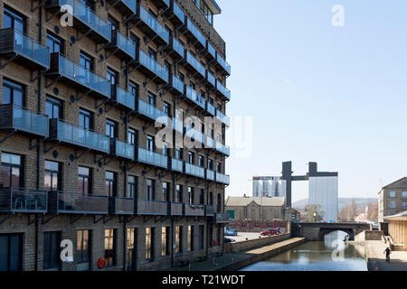 Modern canalside apartments in a refurbished former mill, Brighouse, West Yorkshire - Stock Image