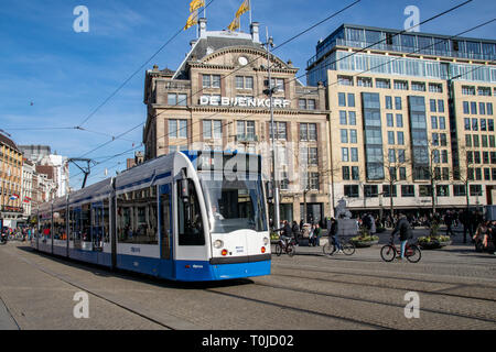 Transport around Amsterdam with trams and bicycle lanes. The Netherlands, February 2019 - Stock Image