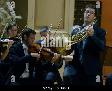 Prague, Czech Republic. 19th May, 2019. French horn player Alexandre Collard, right, performs with the Prague Philharmonia conducted by Ben Glassberg of Britain during the Prague Spring International Music Festival in Prague, Czech Republic, May 19, 2019. Credit: Michaela Rihova/CTK Photo/Alamy Live News - Stock Image